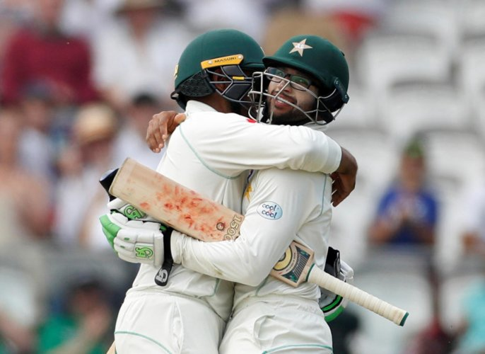 SUPERP START Pakistan's Imam-ul-Haq (right) and Haris Sohail celebrate after beating England in the first Test at Lord's on Sunday. Reuters