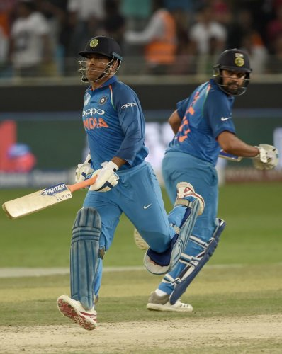 KEY MEN: Skipper Rohit Sharma's form and veteran Mahendra Singh Dhoni getting amongst runs augurs well for India. AFP