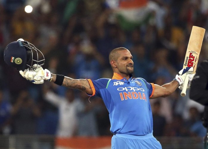 IN SUBLIME TOUCH: India's Shikhar Dhawan celebrates after scoring a century against Pakistan in Dubai on Sunday. AP/PTI