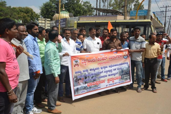 Vishwa Hindu Parishad and Bajrang Dal activists protest in Chikkamagaluru on Friday against the Pulwama attack in Jammu and Kashmir.