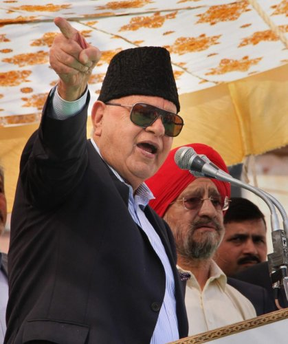 National Conference President Farooq Abdullah addresses a joining function for new party members, in Jammu, Sunday, March 17, 2019. (PTI Photo)