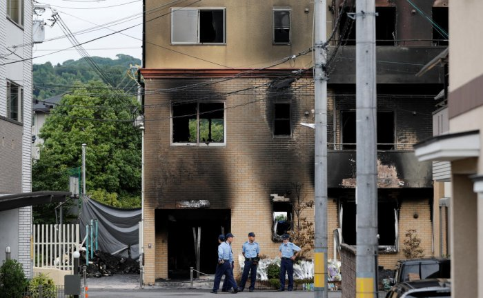 Policemen are seen at the torched Kyoto Animation building in Kyoto. (Reuters Photo)