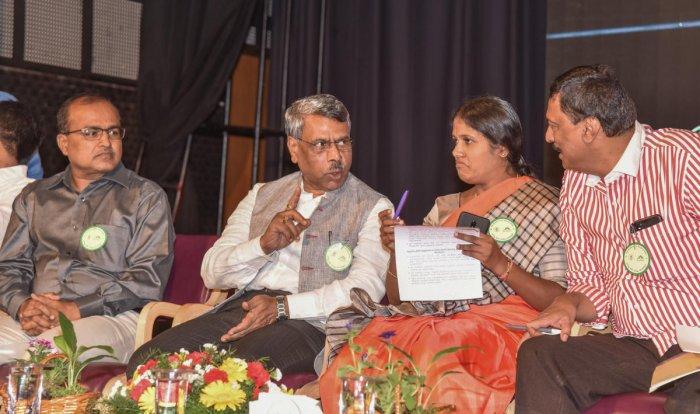 KSPCB's Manoj Kumar, Justice Subhash Adi, Mayor Gangambike Mallikarjun and BBMP corporator Mohammad Rizwan Navab at a state-level meeting of solid waste management stakeholders in Bengaluru on Sunday. (DH Photo)