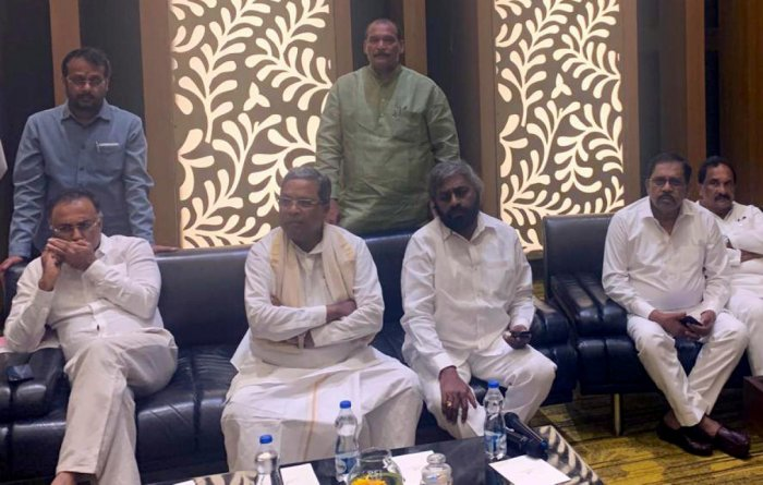 Congress leaders Siddaramaiah, Dinesh Gundu Rao and G Parameshwara at the CLP meeting in Bengaluru on Sunday.