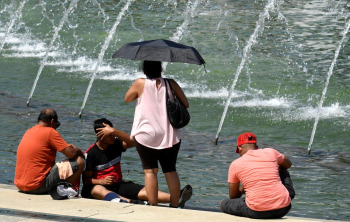 Tourists attempt to cool off at a fountain at the World War II Memorial on the National Mall during a heat wave, in Washington, DC (Reuters Photo)