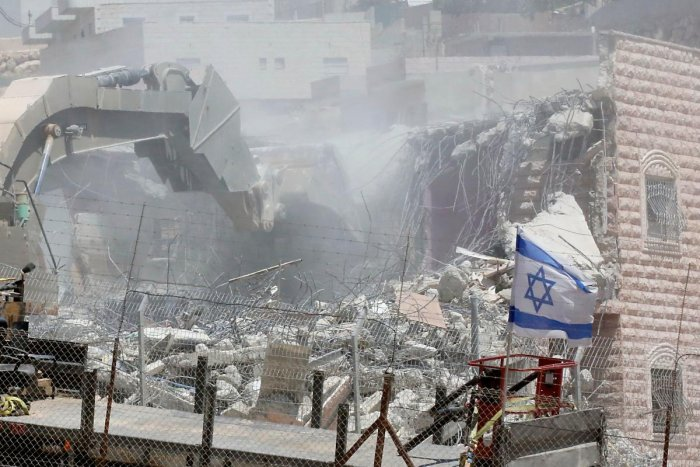 Israel says the buildings were built too close to the separation barrier that it built to stop attacks from the West Bank. Palestinians accuse Israel of using security as a pretext to force them out of the area, meant to be under Palestinian Authority civilian control under the Oslo accords, as part of long-term efforts to expand settlements and roads linked them. Photo/AFP