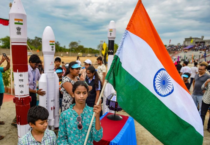 People celebrate with a Tricolour the successful launch of India's second Moon mission Chandrayaan-2 by GSLV Mk III-M1 launch vehicle, in Sriharikota, Andhra Pradesh, Monday, July 22, 2019. Photo credit: PTI
