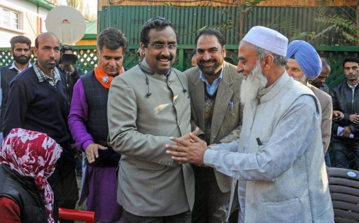 Bharatiya Janata Party (BJP) National General Secretary Ram Madhav interacts with a supporter during a rally to celebrate the party's victory in the recent urban local bodies elections, in Srinagar. PTI File photo