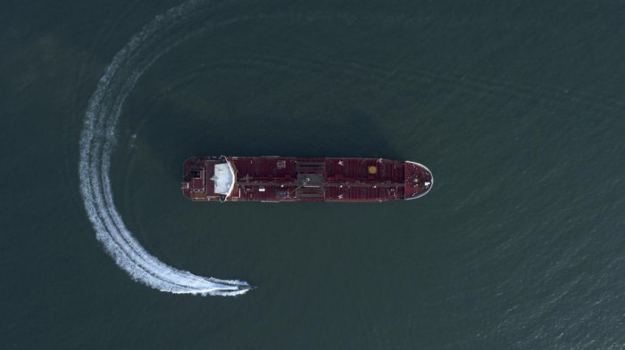 An aerial view shows a speedboat of Iran's Revolutionary Guard moving around the British-flagged oil tanker Stena Impero which was seized in the Strait of Hormuz in the Iranian port of Bandar Abbas (AP/PTI Photo)