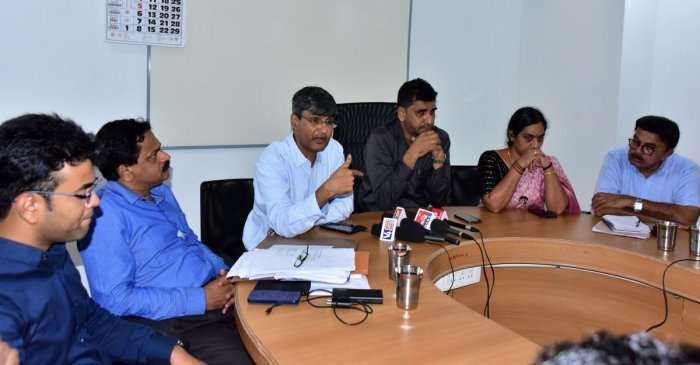 Senior physician Dr Srinivasa Kakkillaya speaks at a press meet at Mangaluru City Corporation on Monday.