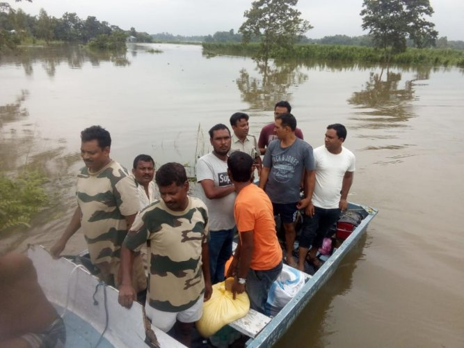 BSF personnel rescued several flood-affected persons in western Assam. (DH Photo)