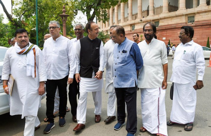 Leader of Opposition in the Rajya Sabha Ghulam Nabi Azad along with other opposition leaders walks to address the media on the Kashmir issue, at Parliament House complex in New Delhi, Tuesday, July 23, 2019. (PTI Photo)