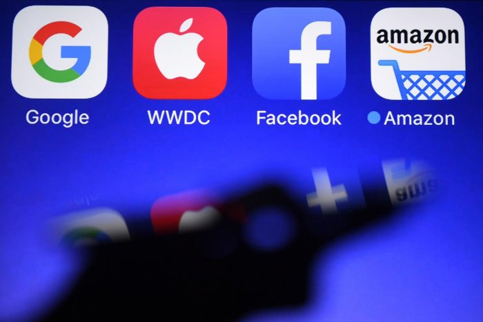 Internet giants like Facebook, Google and Amazon have disrupted markets and culture in a lucrative rise to power. (AFP Photo)
