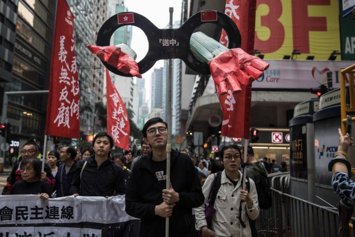Protesters march along a street during a rally in Hong Kong on March 31, 2019, to protest against the government's plans to approve extraditions with mainland China, Taiwan and Macau. (AFP Photo)