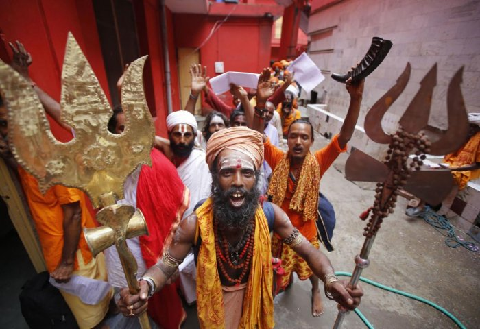 Jammu: Pilgrims chant religious slogans as they stand in a queue to get themselves registered for Amarnath Yatra, at Ram Mandir base camp in Jammu. (PTI Photo)