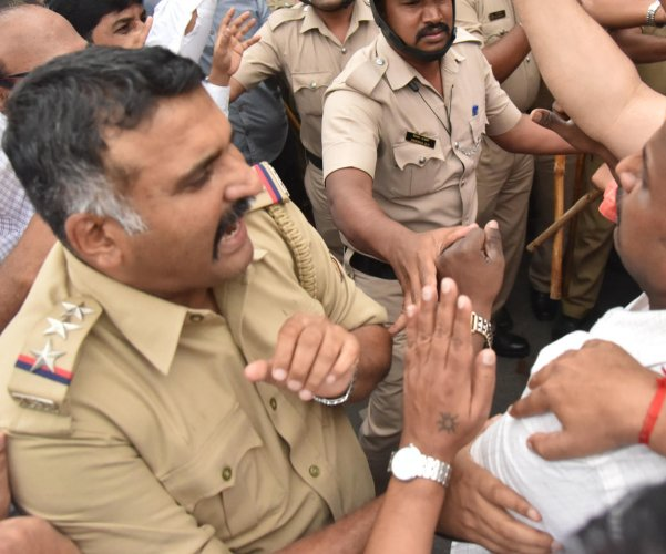 High Grounds Police Inspector E I Sirajuddin during the scuffle on Race Course Road on Tuesday.