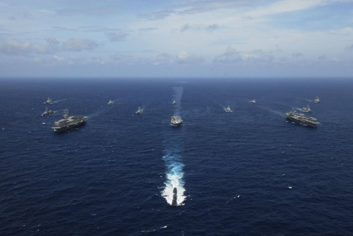 Naval ships from India, Australia, Japan, Singapore, and the United States steam in formation in the Bay of Bengal during Exercise Malabar 07-2. US Navy photo/Stephen Rowe