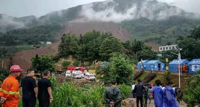 Rescuers gather at the site of a landslide in Liupanshui in China's southwestern Guizhou province on July 24, 2019. Photo credit: AFP
