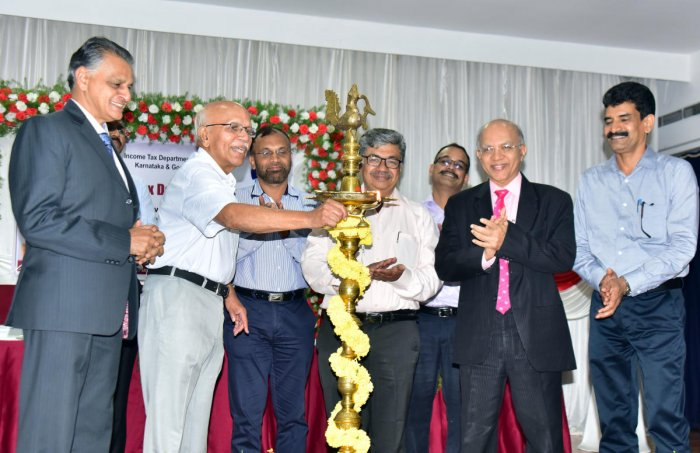 Dr B M Hegde, former vice chancellor of Manipal Academy of Higher Education, inaugurates the Income Tax Day programme at IMA Hall in Mangaluru on Wednesday.