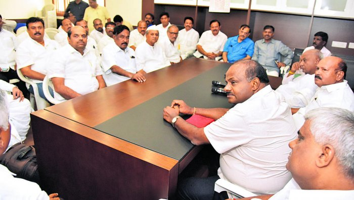 Former minister H D Revanna, caretaker Chief Minister H D Kumaraswamy, JD(S) working president H K Kumaraswamy and former prime minister H D Devegowda and others take part in JDS legislature party meeting in Bengaluru on Wednesday. (DH Photo)