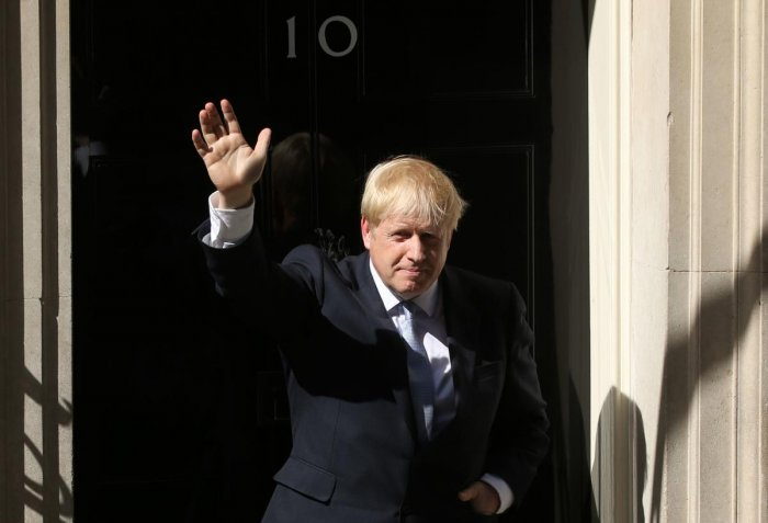 Britain's new Prime Minister Boris Johnson gestures after giving a speech outside 10 Downing Street in London on July 24, 2019. Photo credit: AFP