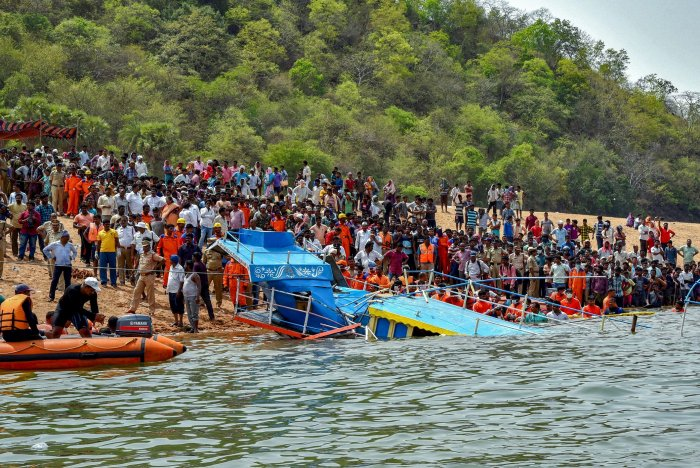 Rescue teams carry out operations after an open motor boat carrying 40 people capsized in Godavari river in East Godavari district on Wednesday.PTI