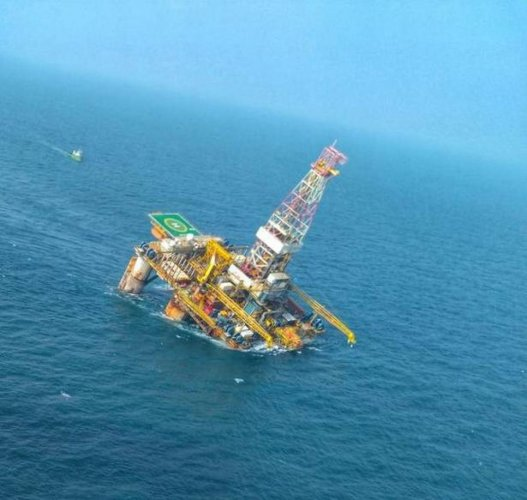The tilted deck of the ONGC oil rig in the Bay of Bengal off Andhra Pradesh coast. Photo: Twitter/@indiannavy