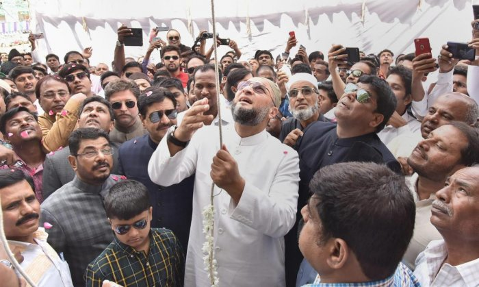 AIMIM chief and MP Asaduddin Owaisi hoists the party flag on the occasion of 61st AIMIM formation day celebrations at the party headquarter, in Hyderabad on March 2, 2019. PTI