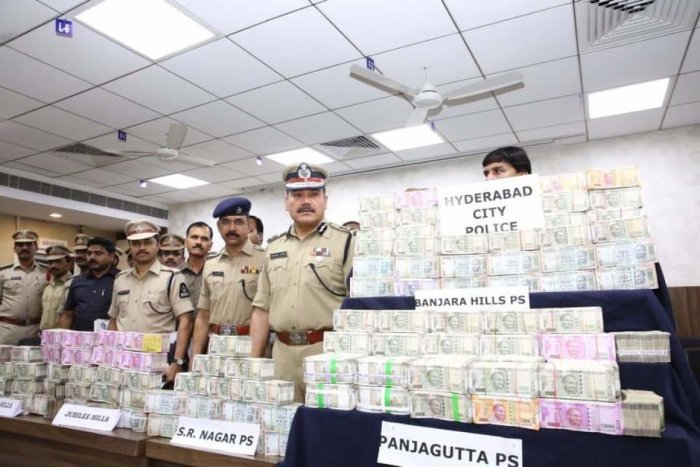 Hyderabad Commissioner of Police Anjani Kumar with the bundles of seized cash Rs 4.92 crore