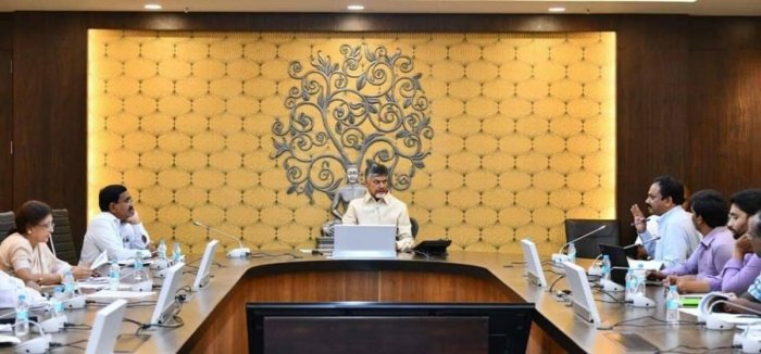 Andhra Pradesh CM Nara Chandrababu Naidu reviewing the works in the state capital on Thursday at his official residence in Amaravati. DH PHOTO