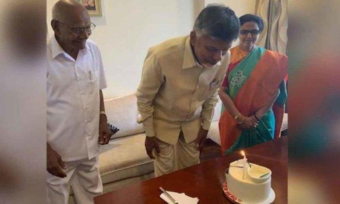 Naidu cutting cake in Hyderabad residence on Saturday