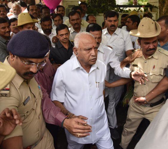 State BJP president B S Yeddyurappa comes out of his house in Bengaluru on Wednesday. (DH Photo/Janardhan B K)