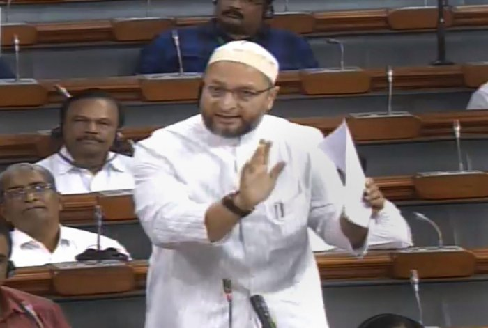 AIMIM MP Asaduddin Owaisi speaks in the Lok Sabha during the Budget Session of Parliament, in New Delhi, Thursday, July 25, 2019. (LSTV/PTI Photo)