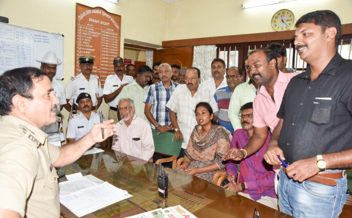 Traders request Assistant Commissioner of Police (Traffic) G N Mohan to relax no-parking norms at Santepet in Mysuru on Thursday.