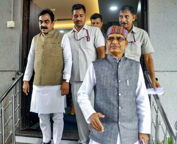BJP national vice-president Shivraj Singh Chouhan and BJP state President Rakesh Singh leave after a meeting with state party leaders, in Bhopal, on Thursday. PTI