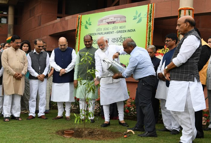 Modi, along with others, planted saplings during the drive. (PIB India/Twitter)