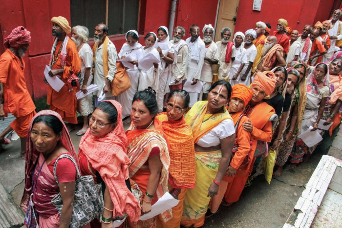 Pilgrims stand in queues to get themselves registered for Amarnath Yatra, at a base camp, in Jammu. (PTI Photo)