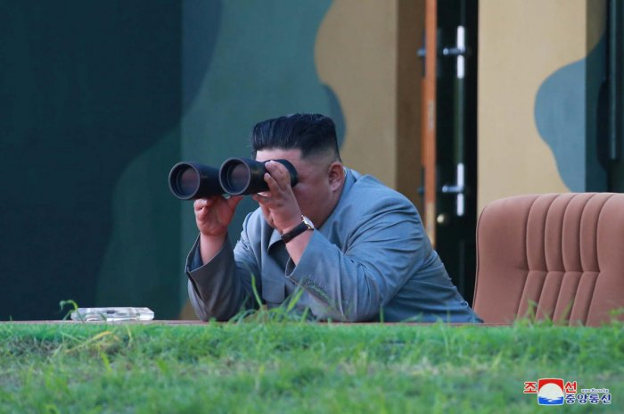 North Korean leader Kim Jong Un watches the test-fire of two short-range ballistic missiles on Thursday, in this undated picture released by North Korea's Central News Agency (KCNA) on July 26, 2019. (KCNA/via REUTERS)