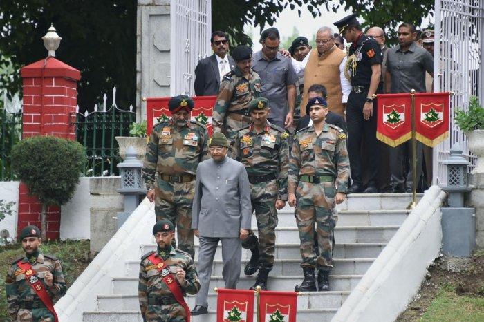 President Ram Nath Kovind accompanied by Jammu and Kashmir Governor Satya Pal Malik and GoC 15 Corps Lt General KJS Dhillon arrive to pay tributes to Kargil war martyrs on the 20th anniversary of Kargil Vijay Diwas. Photo credit: PTI