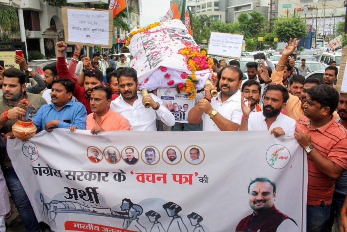Bharatiya Janata Yuva Morcha (BJYM) activists take out a mock funeral rally of Congress party's election manifesto, over not fulfiling the promises made before the State Assembly elections, in Bhopal. Photo credit: PTI