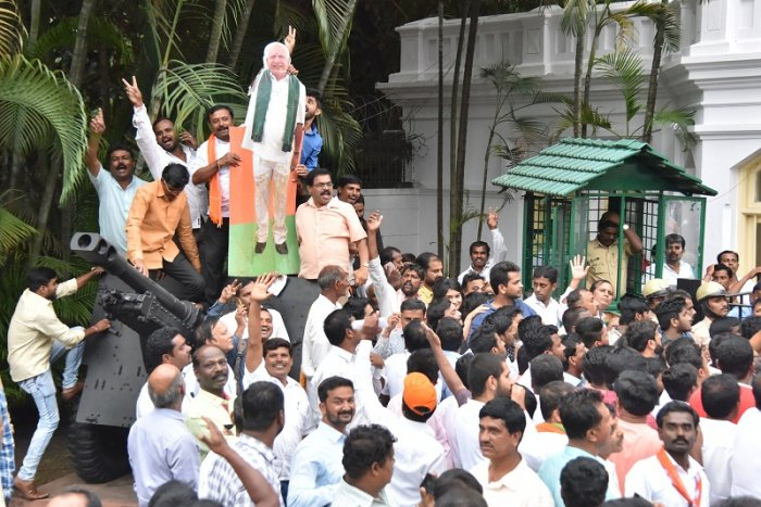 upporters in front of Raj Bhavan during Chief Minister Designated B S Yediyurappa taking vote ceremony in Bengaluru.