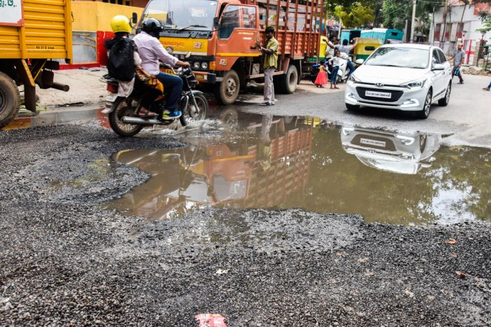 Sewage water stagnanted on the newly asphalted road, and road is fully damaged at BTS (BMTC) Road, near MICO back gate, Wilson garden, in Bengaluru on Sunday. Photo by S K Dinesh