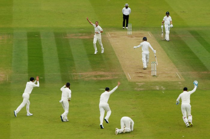 England's Stuart Broad celebrates taking the wicket of Ireland's Andy McBrine after England's Joe Root takes the catch. Photo credit: Reuters