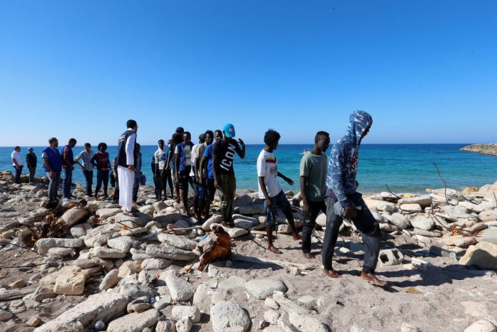 Migrants are seen after being rescued by the Libyan coast guard in Tripoli, Libya. (Reuters PhotO)