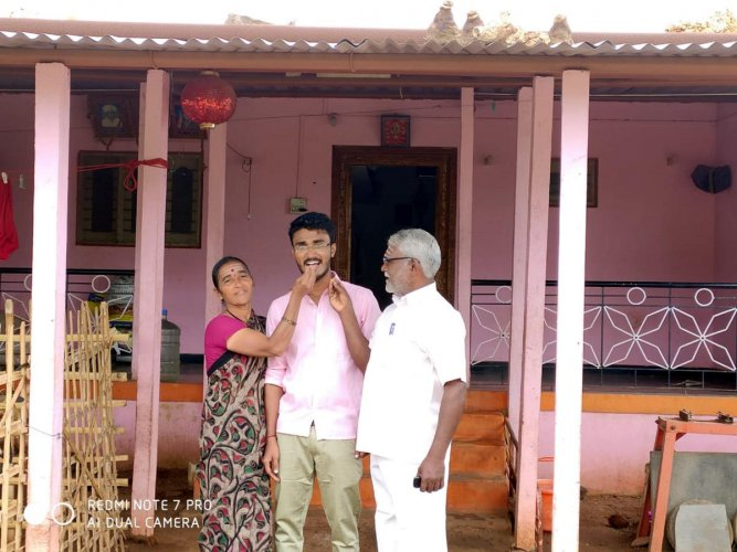 Chetan Baraker with his parents.