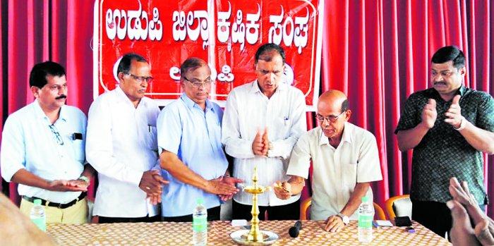 Farmer K Manjunath Nayak inaugurates a workshop for farmers organised at Udupi Residency Hotel on Saturday.