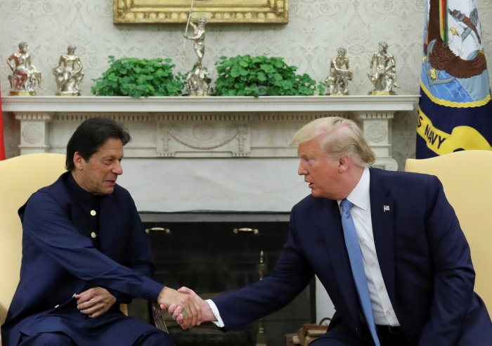 U.S. President Donald Trump greets Pakistan's Prime Minister Imran Khan in the Oval Office at the White House in Washington. (Reuters Photo)