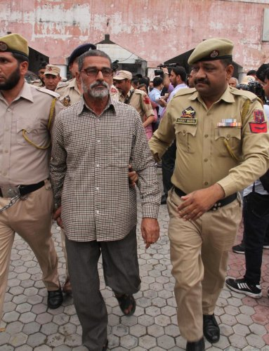 Sanji Ram, the main accused in Kathua rape and murder case, being produced in District Court in Kathua, about 85km from Jammu on Monday. (PTI Photo)