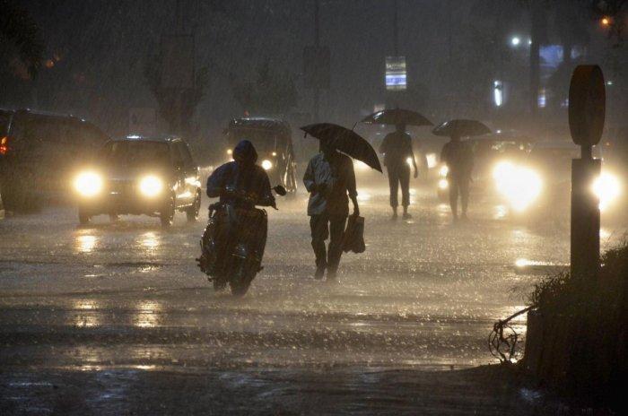 Vehicles ply near Vashi railway station during heavy monsoon rain, in Navi Mumbai (PTI Photo)