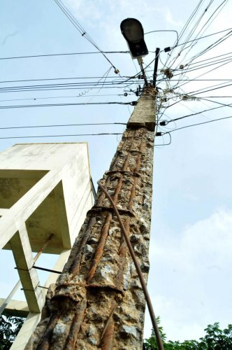 An electricity pole behind the District Ayush Hospital at Azad Park Circle in Chikkamagaluru is in a dilapidated condition.